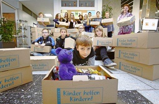 Jugendliche helfen Kindern. Foto: factum/Granville