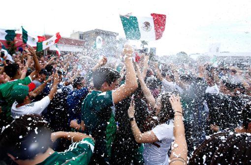 Ein Sieg gegen den Weltmeister – das gibt es nicht alle Tage. Foto: AFP